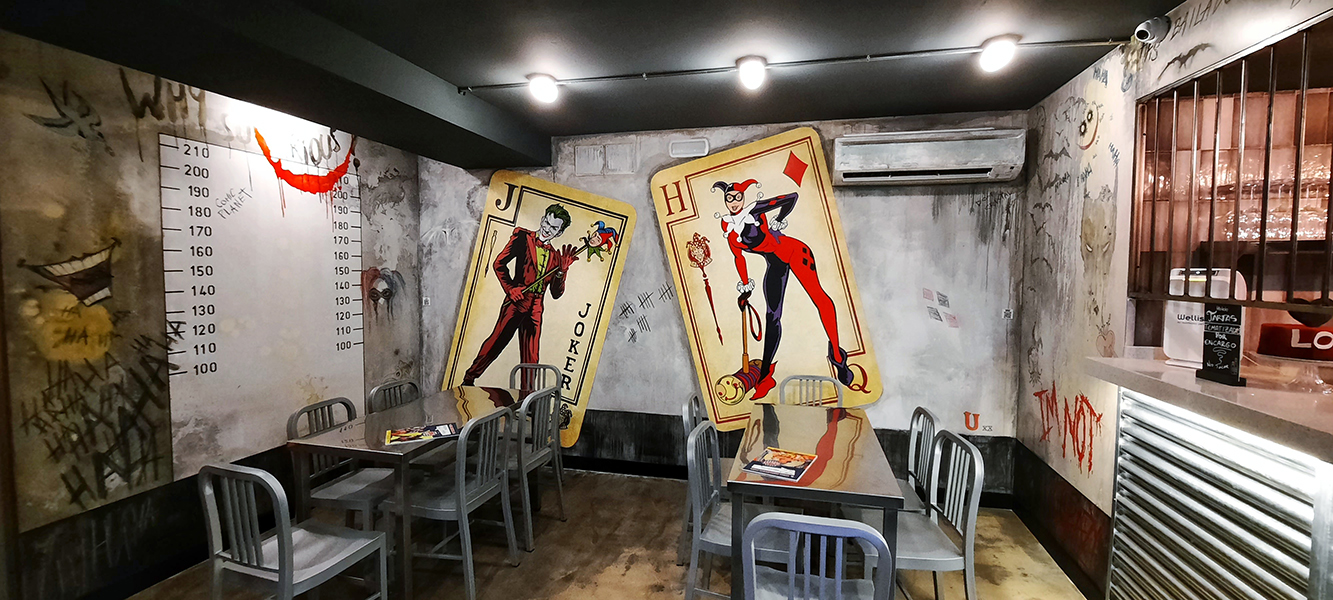 Murales de Harley Quinn y el Joker en Comic Planet.